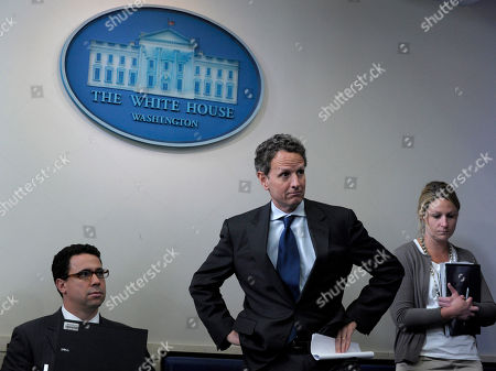 Timothy Geithner, Bill Burton Treasury Secretary Timothy Geithner, center, waits to speak at the daily briefing at the White House in Washington, . At left is Deputy White House Press Secretary Bill Burton