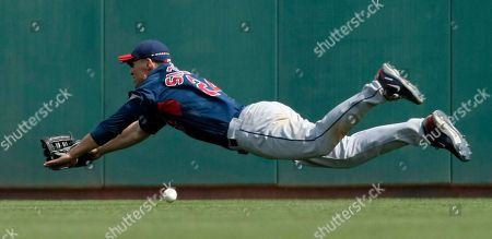Garret Anderson, Grady Sizemore Cleveland Indians center fielder Grady Sizemore dives for a triple hit by Los Angeles Dodgers' Garret Anderson in the fourth inning in a spring training baseball game in Glendale, Ariz. The Indians won 12-5