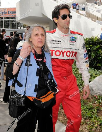 Adrien Brody, Sylvia Plachy Actor Adrien Brody walks with his mother Sylvia Plachy as he prepares for the Toyota Pro-Celebrity auto race event at the Toyota Grand Prix of Long Beach, in Long Beach, Calif