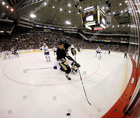 Bill Guerin In this image made with a fisheye lens, Pittsburgh Penguins' Bill Guerin (13) controls the puck in the second period of the NHL hockey game against the Toronto Maple Leafs in Pittsburgh, . The Penguins won 5-4 in a shootout