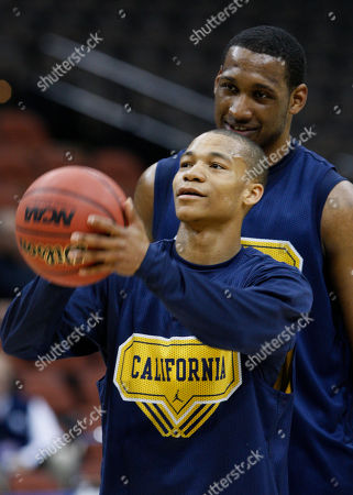 Markhuri Sanders-Frison, Jerome Randle California's Markhuri Sanders-Frison watches as Jerome Randle shoots during a NCAA college basketball practice in Jacksonville, Fla., . California plays Louisville in a first round game on Friday