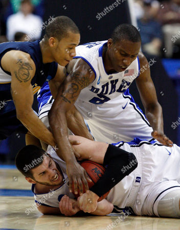 Brian Zoubek, Nolan Smith Jerome Randle Duke's Brian Zoubek, below, and Nolan Smith and California's Jerome Randle fight over a loose ball during the first half of an NCAA second-round college basketball game in Jacksonville, Fla
