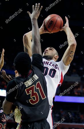Robert Sacre, Chris Singleton Gonzaga's Robert Sacre (00) shoots against Florida State's Chris Singleton (31) during the second half of an NCAA first-round college basketball game in Buffalo, N.Y.,. Gonzaga won 67-60