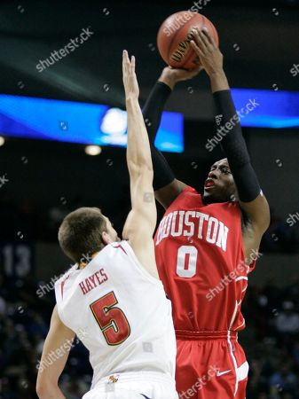 Stock Photo of Kelvin Lewis Houston's Kelvin Lewis (0) shoots against Maryland's Eric Hayes in the first half of an NCAA first-round college basketball game in Spokane, Wash