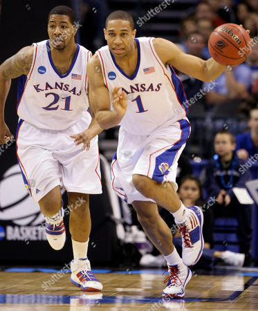 Xavier Henry, Markieff Morris Kansas guard Xavier Henry (1) dribbles upcourt with teammate center Markieff Morris (21) during the first half of an NCAA college basketball game against Lehigh, in Oklahoma City