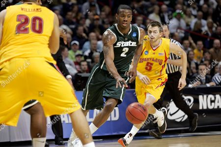 Stock Image of Raymar Morgan Michigan State's Raymar Morgan (2) dribbles as Maryland's Eric Hayes (5) follows in the first half of an NCAA second-round college basketball game in Spokane, Wash