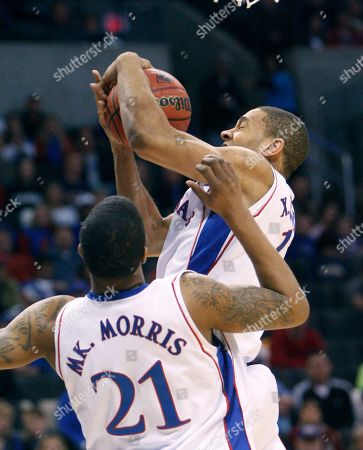 Xavier Henry Kansas guard Xavier Henry pulls down an offensive rebound in front of teammate center Markieff Morris (21)during the first half of an NCAA second-round college basketball game, in Oklahoma City