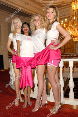 Stock Photo of The cast of the West End show, Dirty Dancing 'go pink' for a charity gala performance in aid of Breast Cancer Care (left to right, Tanya Perera, Nadia Coote and Isabella Anstruther Gough Calthorpe)