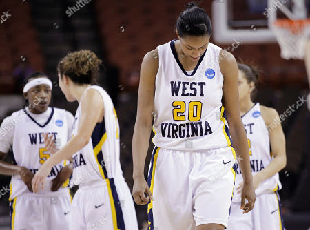 Asya Bussie, Sarah Miles, Liz Repella West Virginia's Asya Bussie (20) and teammates, from left, Sarah Miles, Liz Repella, and Vanessa House walk up the court during the final moments of a second-round NCAA college basketball tournament game against San Diego State, in Austin, Texas. San Diego State won 64-55