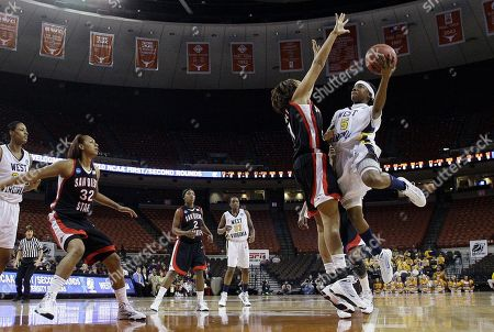 Jessika Bradley, Sarah Miles West Virginia's Sarah Miles, right, shoots against San Diego State's Jessika Bradley during the first half of a second-round NCAA college basketball game, in Austin, Texas