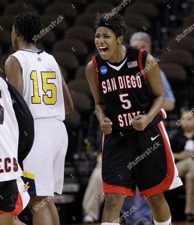 Sarah Miles San Diego State's Jene Morris (5) celebrates after the team's 64-55 win over West Virginia in the second round of the NCAA college basketball tournament, in Austin, Texas