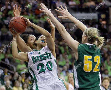 Sofia Iwobi, Alissa Sheftic, Ashley Barlow Notre Dame's Ashley Barlow (20) shoots between Vermont's Alissa Sheftic (52) and Sofia Iwobi in the first half of an NCAA second-round college basketball tournament game in South Bend, Ind