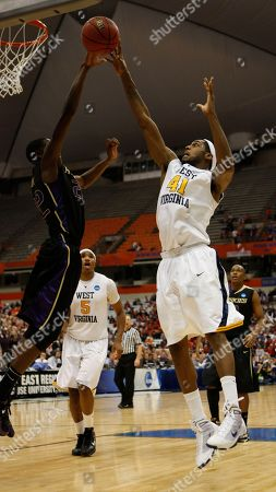 John Flowers, Justin Holiday West Virginia's John Flowers (41) shoots over Washington's Justin Holiday (22) during the second half of a semifinal in the East Regional of the NCAA college basketball tournament, in Syracuse, N.Y