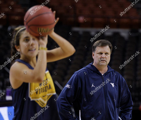 Liz Repella, Mike Carey West Virginia coach Mike Carey, right, watches as Liz Repella shoots during an NCAA college basketball practice, in Austin, Texas. West Virginia will face Lamar in a first-round game Sunday