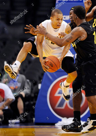 Jerome Randle, Malcolm Armstead California's Jerome Randle, left, jumps to pass the ball as Oregon's Malcolm Armstead, right, defends during the first half of an NCAA college basketball game at the Pac-10 Conference tournament, in Los Angeles
