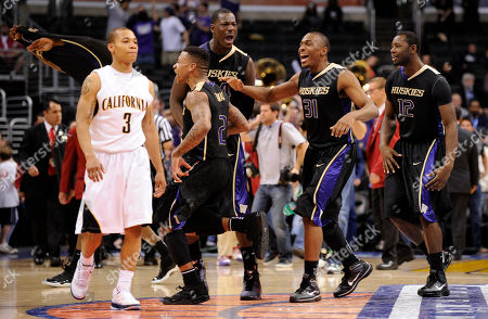 Jerome Randle Washington players celebrates as California's Jerome Randle, left, walks off the court after an NCAA college basketball game at the Pac-10 Conference tournament, in Los Angeles. Washington won 79-75