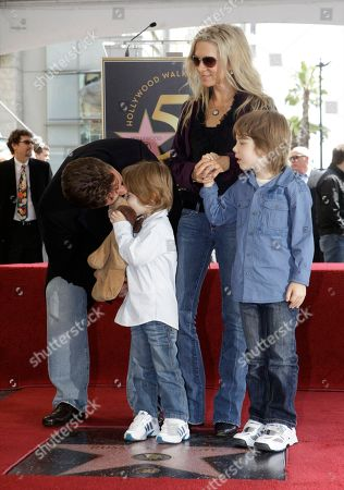 Russell Crowe, Danielle Spencer Academy Award winning actor Russell Crowe leans down to kiss his son Tennyson Spencer Crowe, left, as his wife Danielle Spencer, and their son Charles Spencer Crowe, right, look on during a ceremony to honor him with a star on the Hollywood Walk of Fame, in Los Angeles