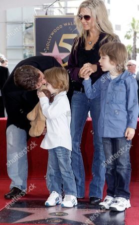 Russell Crowe, Danielle Spencer Academy Award actor Russell Crowe leans down to kiss his son Tennyson Spencer Crowe, left, his wife Danielle Spencer, and their son Charles Spencer Crowe, right, as he was honored with a star on the Hollywood Walk of Fame, in Los Angeles