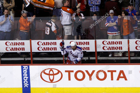 Aaron Voros New York Rangers' Aaron Voros watches from the bench as the Philadelphia Flyers celebrate after their NHL hockey game, in Philadelphia. The Philadelphia Flyers are in the playoffs while eliminating the New York Rangers with a 2-1 victory