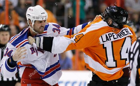 Ian Laperriere, Aaron Voros New York Rangers' Aaron Voros, left, and Philadelphia Flyers' Ian Laperriere fight in the second period of an NHL hockey game, in Philadelphia