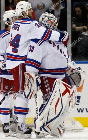 Aaron Voros, Henrik Lundqvist New York Rangers left wing Aaron Voros (34) embraces goalie Henrik Lundqvist (30), of Sweden, after the Rangers' 4-3 victory over the New York Islanders in an NHL hockey game at Nassau Coliseum in Uniondale, N.Y
