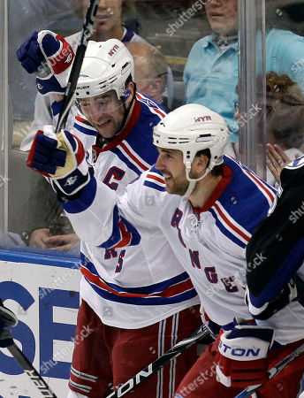 Stock Image of Aaron Voros, Chris Drury New York Rangers left winger Aaron Voros, foreground, celebrates his goal with teammate Chris Drury against the Tampa Bay Lightning during the third period of an NHL hockey game, in Tampa, Fla
