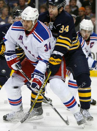 Chris Butler, Aaron Voros New York Rangers' Aaron Voros (34) battles in front of the goal with Buffalo Sabres' Chris Butler (34) during the second period of an NHL hockey game in Buffalo, N.Y