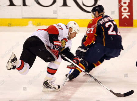 Alexei Kovalev, Steve Reinprecht Ottawa Senators' Alexei Kovalev, left, of Russia, gains control of the puck over Florida Panthers' Steve Reinprecht, right, during the first period of an NHL hockey game in Sunrise, Fla