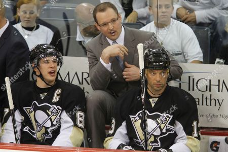 Sidney Crosby, Dan Bylsma, Bill Guerin Pittsburgh Penguins' Sidney Crosby, left, talks with coach Dan Bylsma, center, between shifts during the first period of a first-round NHL playoff hockey game against the Ottawa Senators in Pittsburgh . The Penguins won 2-1. At right is Penguins' Bill Guerin