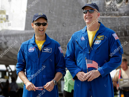 James Dutton, Alan Poindexter Space shuttle Discovery pilot James Dutton, left, and commander Alan Poindexter after landing at the Kennedy Space Center in Cape Canaveral, Fla