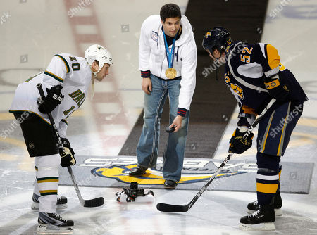 Steve Mesler, Craig Rivet, Brenden Morrow Olympic gold medalist Steve Mesler, center, drops the ceremonial puck for Buffalo Sabres' Craig Rivet (52) and Dallas Stars' Brenden Morrow (10) before the NHL hockey game in Buffalo, N.Y