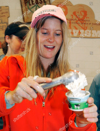 Snowboard Olympic medalist Hannah Teter scoops a cup of the flavor, Maple Blondie, made in her name by Ben & Jerry's ice cream during a ceremony in Burlington, Vt