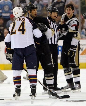 Chris Chelios, Evgeni Malkin, Bill Guerin Atlanta Thrashers' Chris Chelios, right, is kept away from Pittsburgh Penguins' Evgeni Malkin, right, of Russia, by Penguins' Bill Guerin, center, after a scuffle in the second period of the NHL hockey game in Pittsburgh, . The Penguins won 4-3 in overtime