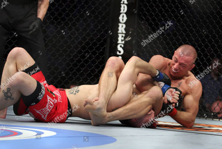 Georges St. Pierre, Dan Hardy UFC Welterweight Champion Georges St. Pierre, right, attempts an armbar against Dan Hardy during their match at the Prudential Center in Newark, NJ on . St. Pierre methodically defeated challenger Dan Hardy by a unanimous five-round decision in the main event of UFC 111 and retained his welterweight championship Saturday night