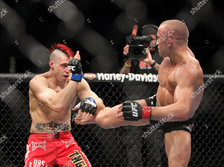 Georges St. Pierre, Dan Hardy UFC Welterweight Champion Georges St. Pierre, right, attempts a kick against Dan Hardy during their match at the Prudential Center in Newark, NJ on . St. Pierre won a 5-round unanimous decision