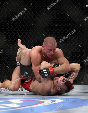 Georges St. Pierre, Dan Hardy UFC Welterweight Champion Georges St. Pierre, top, lands an elbow against Dan Hardy during their match at the Prudential Center in Newark, NJ on . St. Pierre won a 5-round unanimous decision