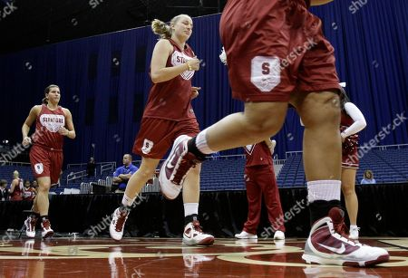Mikaela Ruef, Sarah Boothe Stanford players Sarah Boothe, left and forward Mikaela Ruef, center, run onto the court at the start of practice for the NCAA Women's Final Four college basketball tournament, in San Antonio, Texas. Stanford will play Oklahoma Sunday