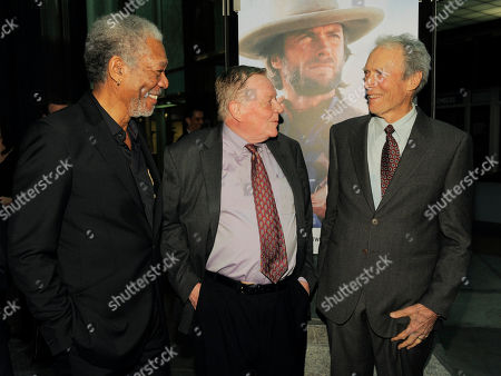 """Stock Picture of Clint Eastwood, Richard Schickel, Morgan Freeman Clint Eastwood, right, mingles with film critic Richard Schickel, center, and actor Morgan Freeman at An Evening with Clint Eastwood, presented by Warner Bros. and the Los Angeles County Museum of Art, in Los Angeles. The event celebrated the debut of the new DVD collection """"Clint Eastwood: 35 Films 35 Years at Warner Bros.,"""" and the world premiere of Richard Schickel's new documentary, """"The Eastwood Factor,"""" narrated by Freeman"""