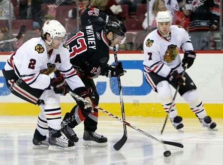 Ray Whitney, Duncan Keith, Brent Seabrook Carolina Hurricanes' Ray Whitney (13) skates as Chicago Blackhawks' Duncan Keith (2) and Brent Seabrook (7) chase during the second period of an NHL hockey game in Raleigh, N.C
