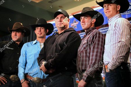 Country Music recording artist and philanthropist Garth Brooks, center, pose with bull riding stars Adriano Moraes, far left, three-time Professional Bull Riders (PBR) world champion, J.B. Mauney, second from left, Kody Lostroh, second from right, PBR 2009 world champion, and Ty Murray, far right, PBR co-founder, during a news conference in New York, . Brooks and the PBR announced a new charitable partnership to support Garth Brooks Teammates for Kids Foundation. The top 40 bull riders in the world will compete at New York's Madison Square Garden Invitational on January 8-10