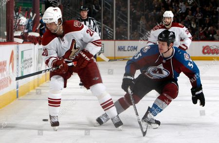 Robert Lang, Cody McLeod Phoenix Coyotes center Robert Lang, left, of the Czech Republic, loses control of the puck as Colorado Avalanche left winger Cody McLeod covers in the second period of an NHL hockey game in Denver on