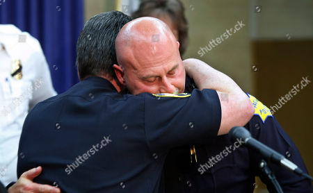 Rick Liles, Jerry Dyer, Steve Wright Fresno Police Chief Jerry Dyer, facing camera, hugs Reedley Police Chief Steve Wright during a news conference in Fresno, Calif., . A sheriff's homicide detective was killed on Thursday in a shootout while serving a search warrant to Rick Liles at a mobile home. Liles was killed, and two other officers were wounded