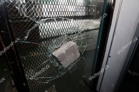 "A shattered door is seen at the Frederick Douglass High School in Detroit. The school is one of 14 empty schools Detroit Schools emergency financial manager Robert Bobb has called the ""worst of the worst"" crime-infested eyesores the shrinking district owns"
