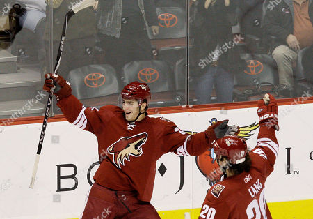 Peter Mueller, Robert Lang Phoenix Coyotes' Peter Mueller, left, celebrates his goal with teammate Robert Lang (20), of the Czech Republic, in the first period of an NHL hockey game against the New Jersey Devils, in Glendale, Ariz