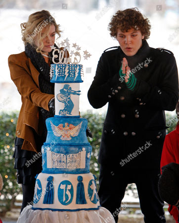 RIley Keough, Benjamin Keough Riley Keough, 21, left, cuts the birthday cake as her brother, Benjamin, 18, right, warms his hands as they take part in a ceremony commemorating Elvis Presley's 75th birthday on in Memphis, Tenn. Both are the children of Lisa Marie Presley and the grandchildren of Elvis Presley