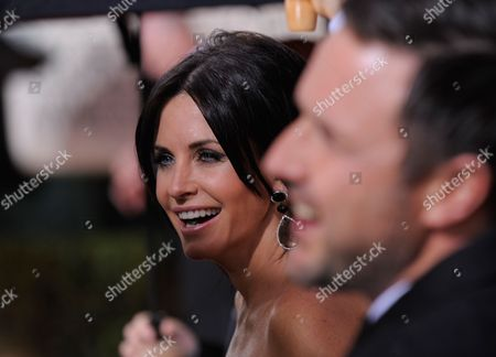 Courtney Cox Arquette Courtney Cox Arquette arrives at the 67th Annual Golden Globe Awards, in Beverly Hills, Calif