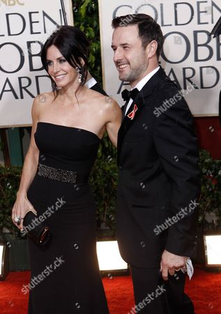 Courtney Cox Arquette, David Arquette Courtney Cox Arquette and David Arquette arrive at the 67th Annual Golden Globe Awards, in Beverly Hills, Calif