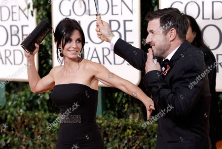 Stock Photo of Courtney Cox Arquette, David Arquette Courtney Cox Arquette and David Arquette arrive at the 67th Annual Golden Globe Awards, in Beverly Hills, Calif