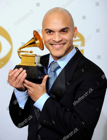 "Irvin Mayfield Irvin Mayfield of the New Orleans Jazz Orchestra holds the large jazz ensemble album award for ""Book One,"" backstage at the Grammy Awards, in Los Angeles"