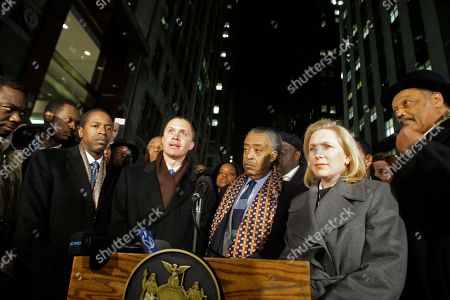"""Al Sharpton, Kirsten Gillibrand Former U.S. Rep. Harold Ford Jr. speaks, as New York State Senator Malcom Smith, left, Rev. Al Sharpton, second from right, and Senator Kirsten Gillibrand, right, look on before a vigil to pray for Hatian earthquake victims outside near the Hatian Consulate in New York. Ford began crafting his argument Tuesday for a potential bid to unseat Sen. Kirsten Gillibrand, reinventing himself as an independent thinker battling """"Washington insiders"""
